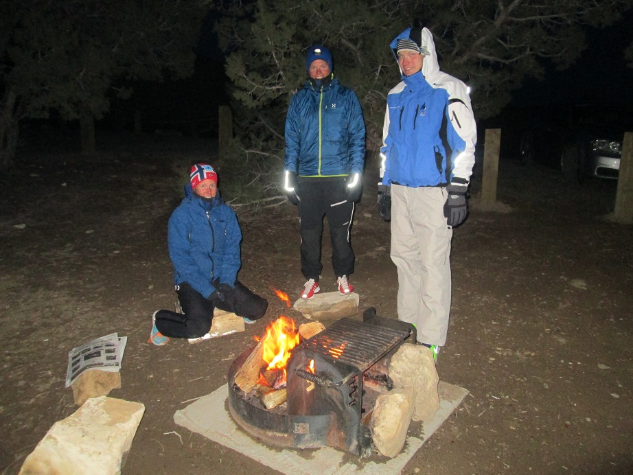 Karel, Kristin and Astrid staying warm by the fire